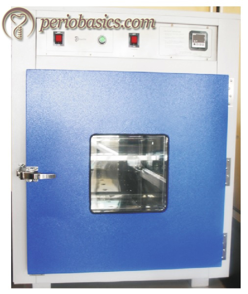 Hot air oven used for dry heat sterilization of instruments.